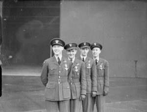 The first four Polish recipients of the Distinguished Flying Cross Polish Fighter Squadron 303 RAF, wearing their awards after a presentation ceremony by Air Marshal W Sholto-Douglas at Leconfield, Yorkshire. Left to right: Squadron Leader Witold Urbanowicz, Pilot Officer Jan Zumbach, Pilot Officer Mirosław Ferić, Flying Officer Zdzisław Henneberg.