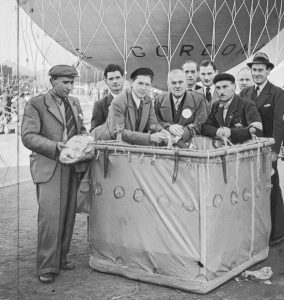 Gordon-Bennett Cup in Liege. The crew of SP-BCU LOPP balloon: Antoni Janusz (third from the left) and Franciszek Janik (on the right, leaning against the balloon's gondola) before take-off.
